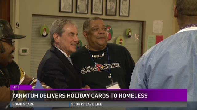 Rep. John Yarmuth (L) stands with a St. John's employee during a Christmas celebration on Dec. 21, 2015