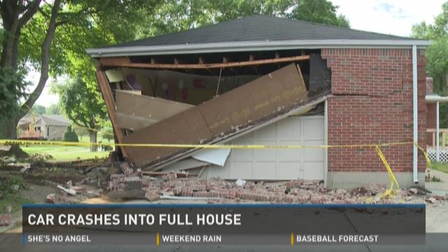 Video | Car crashes into Louisville home