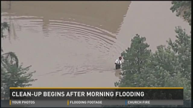 Residents clean up after major flooding